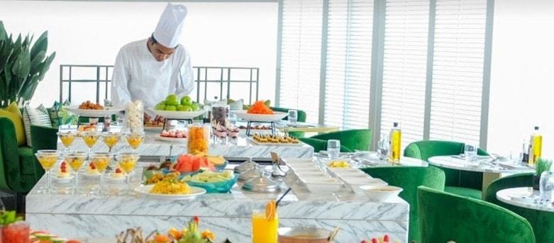 waiter serving food dubai
